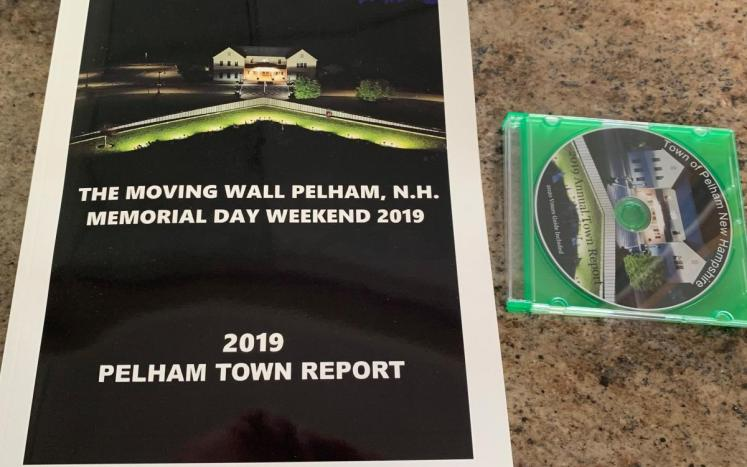 Picture of the 2019 Town Report and CD's with a picture of the Moving Wall.